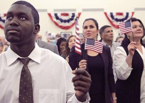 Hearing impaired new U.S. citizen, Willy Theodorice, 26, left, who was born in Haiti, stands with other newly citizens. On Tuesday, Dec. 29, 2015 about 141 citizenship candidates originating from the 37 countries were sworn as the last group of new U.S. citizen for 2015 inside USCIS Miami Field Office in Miami (PHOTO CREDIT: CARL JUSTE, MIAMI HERALD)
